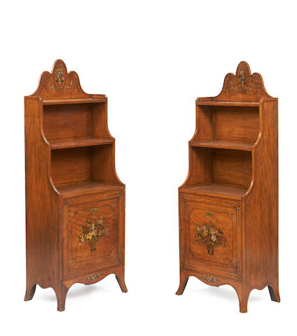 A pair of Edwardian satinwood and polychrome decorated dwarf waterfall bookcases in the Sheraton revival style