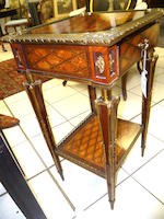 A late 19th century French satinwood, ebony and mahogany veneered and gilt metal mounted occasional table