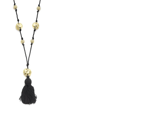 A gold elephant tassel necklace, by Garrard, (illustrated above)