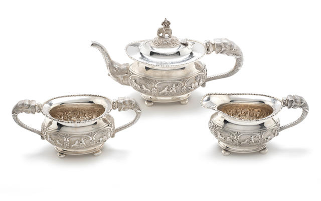 A 20th century Indian silver three-piece tea service stamped 'Vummidiar' 'Pure Silver' to base, probably Bombay c.1920  (3)