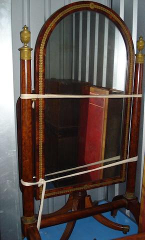 An Empire mahogany cheval glass