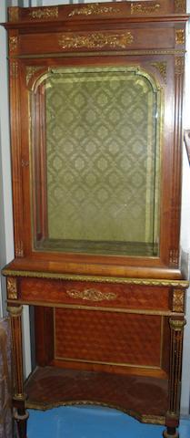 A 19th century French gilt metal mounted kingwood vitrine