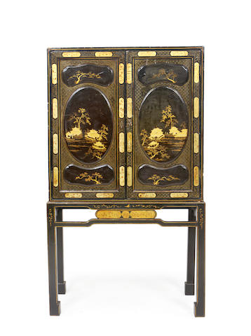 A Chinese Export early 19th century black lacquer cabinet on later stand