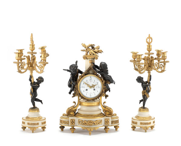 An early 20th century French parcel gilt and patinated bronze and white marble figural clock garniturethe brass movement marked Vincenti