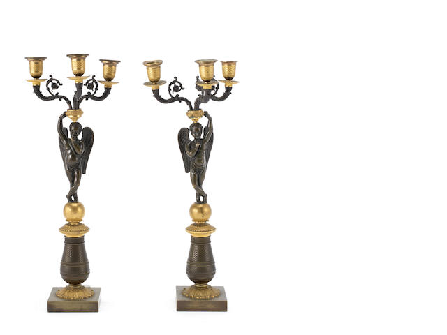 A pair of cherub candelabra