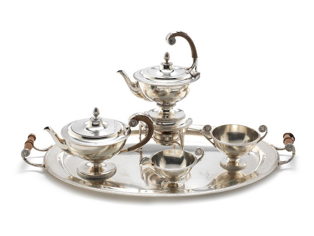 A silver five-piece tea service including kettle on stand and a tray by James Dixon & Son, Sheffield 1912 - 1916  (6)