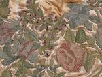 A group of mid 18th century needlework motifs mounted on a later satin ground