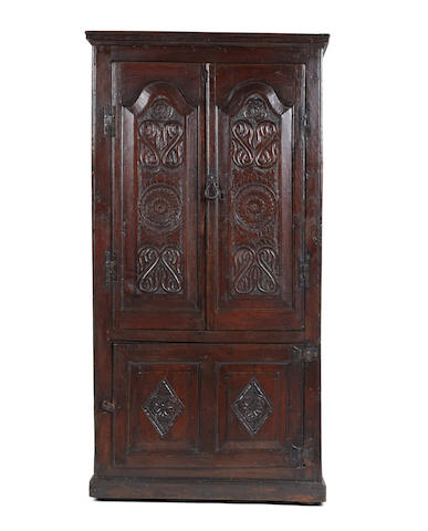 An oak livery cupboard Constructed principally from a larger early 18th century cupboard