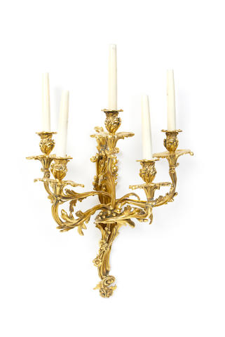 A set of four 20th century gilt brass five light wall appliques in the Louis XV style