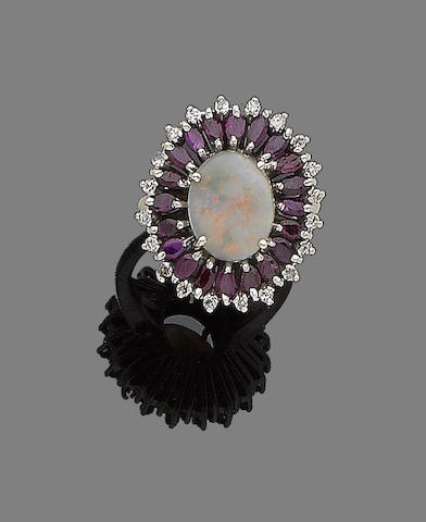 An opal, ruby and diamond dress ring