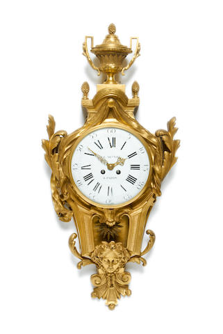A late 19th century gilt bronze cartel clock in the Louis XV style<BR />the dial signed LE NEPVEU A PARIS