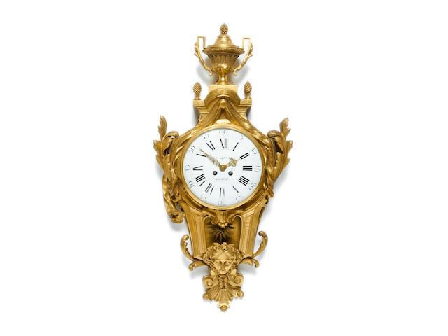 A late 19th century gilt bronze cartel clockin the Louis XV style the dial signed LE NEPVEU A PARIS