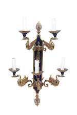 A set of four mid 20th century five light dark green patinated and gilt brass wall appliques in the Empire taste
