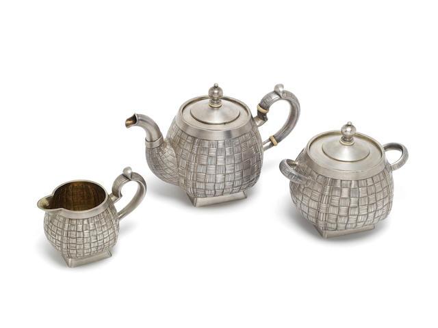 A late-19th century Russian silver trompe-l'œil tea service maker's mark rubbed, possibly for Pyotr Loskutov, Moscow 1888  (3)