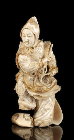 A Japanese carved ivory figure of a Bugaku dancer, Meiji period
