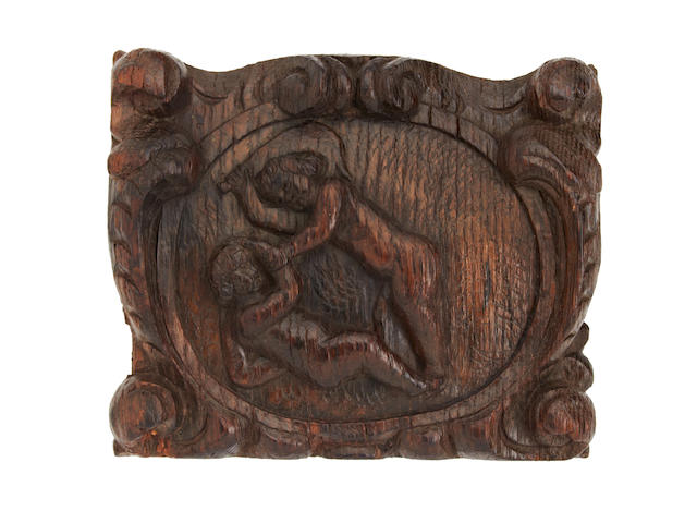 A late 17th century oak relief-carved panel or cartouche