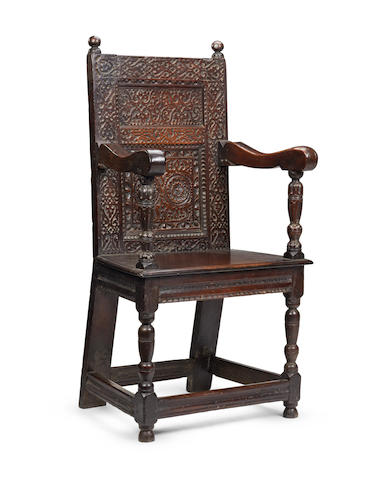 A rare Elizabeth I oak panel-back armchair Circa 1580