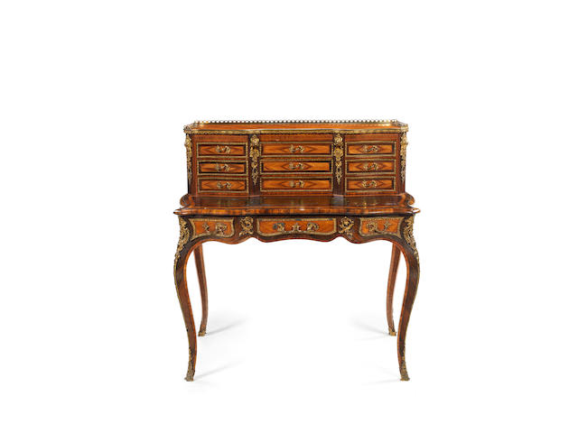 An early Victorian gilt bronze mounted tulipwood, kingwood and rosewood bonheur du jourin the Louis XV style