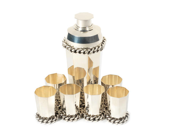 An Art Deco silver cocktail shaker and six matching tots, by Jean Despres, French, 1920s,