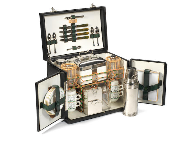A fine specially commissioned Coracle brand picnic set for four persons, by H W Hill of Newmarket, 1925,