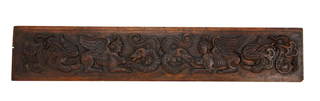 An unusual 16th century carved oak grotesque frieze rail, Franco/Flemish