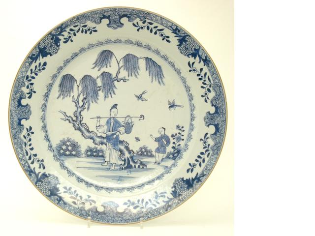 A pair of blue and white dishes, and a similar charger 18th/19th century
