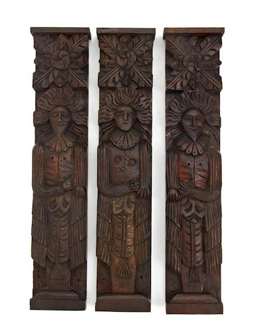 Three early to mid-17th century oak pilasters or figural terms, circa 1630 - 1640