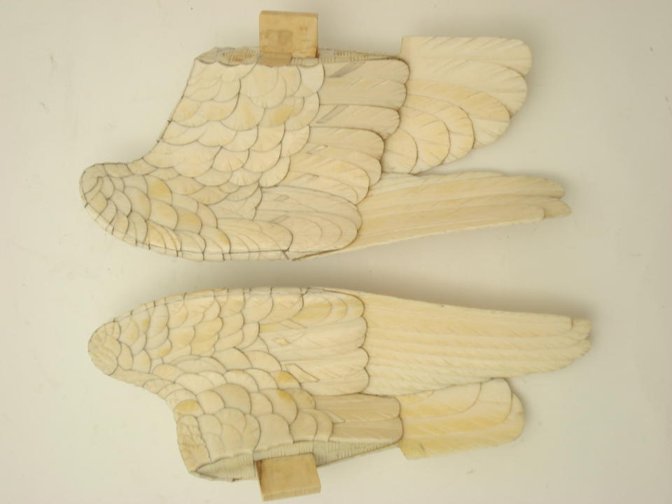 A large and finely carved ivory okimono of a parrot on wood perch Meiji
