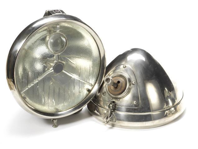 A good pair of Lucas DB100 bullseye electric headlamps,