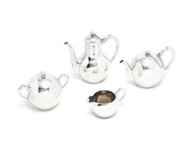 A 19th century Russian silver four-piece tea and coffee service by Sazikov, St Petersburg 1880  (4)