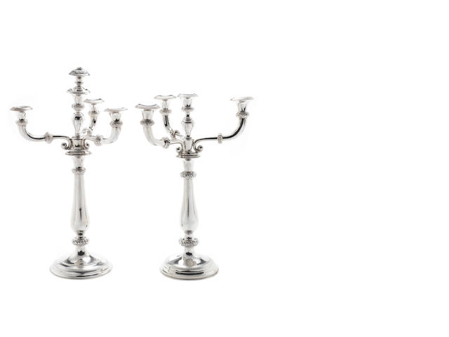 A matched pair of mid 19th century four-light candelabra one silver with Austro-Hungarian, marks for Vienna 1856, the second with distorted marks, branch section apparently unmarked