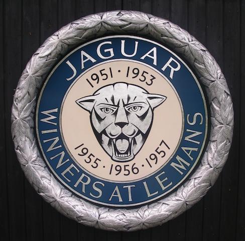 A hand-painted 'Jaguar Le Mans' celebratory roundel,