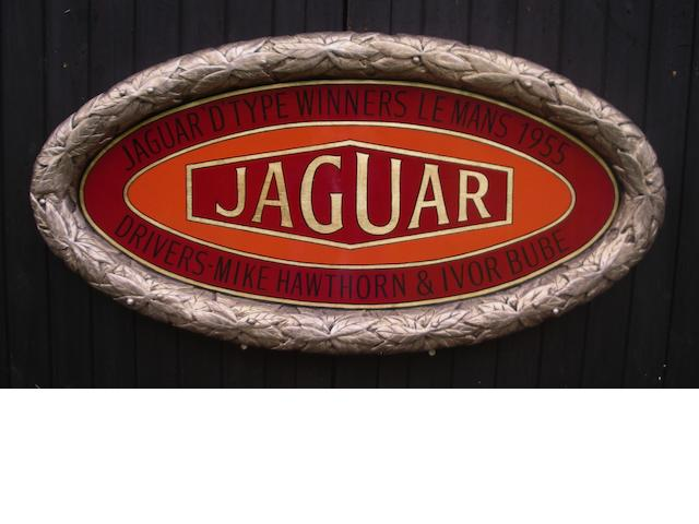 A hand-painted '1955 Le Mans Jaguar D-Type' celebratory oval plaque,