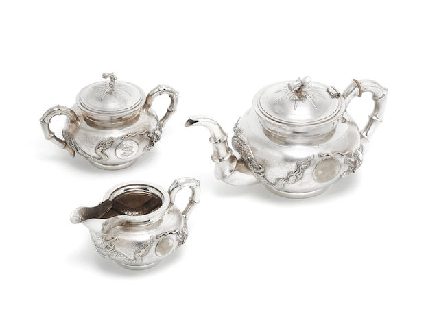 3 piece Chinese silver tea set together with two comb mounts, two mirrors (one lacking mirror) hair brush, and a clothes brush mount