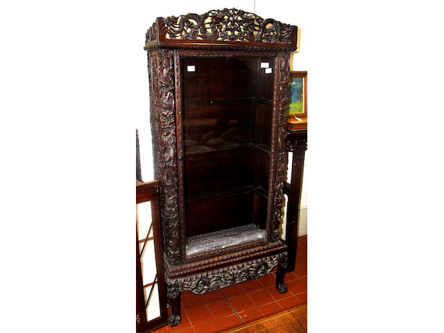 A Chinese carved hardwood display cabinet on stand,