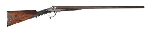 A 10-bore sidelock hammer gun by J. Dickson