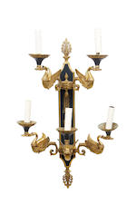 A set of four mid 20th century five light dark green patinated and gilt brass wall appliquesin the Empire taste