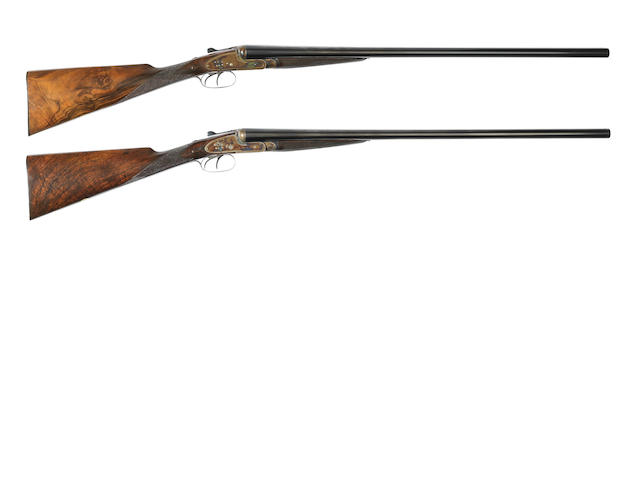 A pair of 12-bore 'Best Quality' sidelock ejector guns by William Powell & Son, No. 10574/5 In their brass-mounted oak and leather case (handle detached)