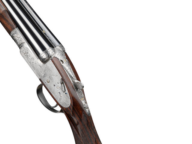 A fine K.C. Hunt engraved 20-bore (2¾in) 'Royal de Lux' single-trigger self-opening sidelock ejector gun by Holland & Holland, no. 40405 In its Holland & Holland leather case