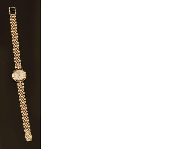Chopard: A lady's 18ct gold and diamond set wristwatch