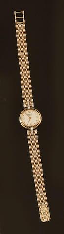 Chopard: A lady's 18ct gold and diamond set wristwatch