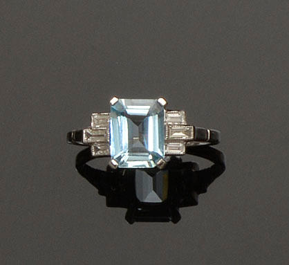 An Art Deco style aquamarine and diamond ring