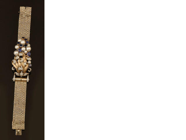 Girard Perregaux: A lady's diamond, sapphire and cultured pearl set bracelet watch