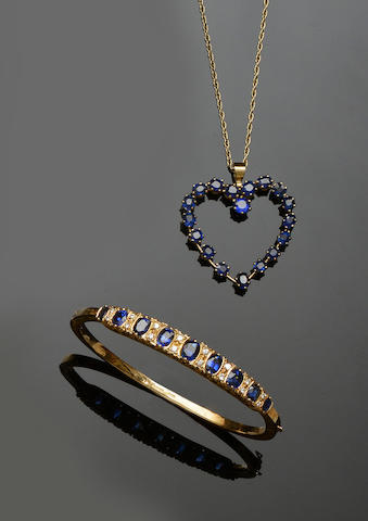 A sapphire and diamond bangle and a sapphire heart pendant (2)