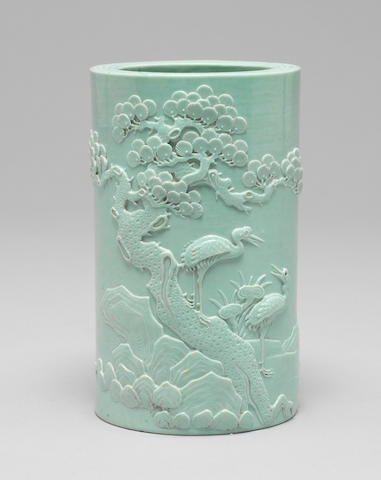 A relief-carved turquoise-glazed brushpot, bitong Carved Kangxi four character seal mark, 19th century