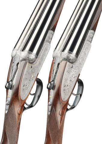 A matched pair of 12-bore 'Royal' sidelock ejector guns by Holland & Holland, no. 16728/27355 In their brass mounted oak and leather case