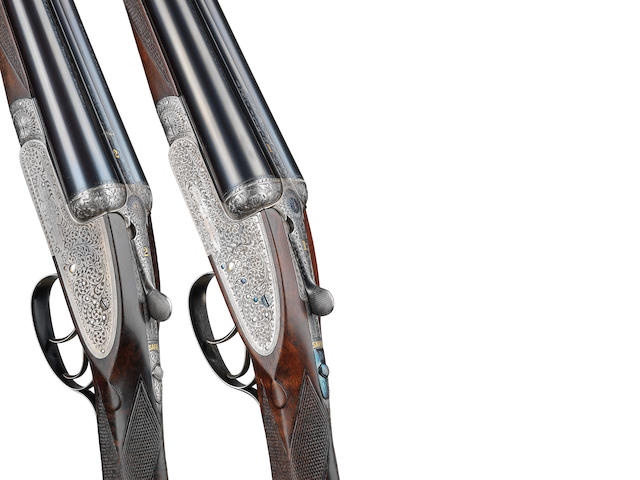 A matched pair of 12-bore 'Royal' sidelock ejector guns by Holland & Holland, no. 27166 /27179 With a Holland & Holland brass-mounted oak and leather single-guncase (for gun No. 27166) and a J. Purdey leather motor-case with a Holland & Holland trade-label
