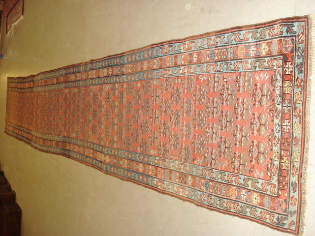 A North West Persian runner, 529cm x 88cm