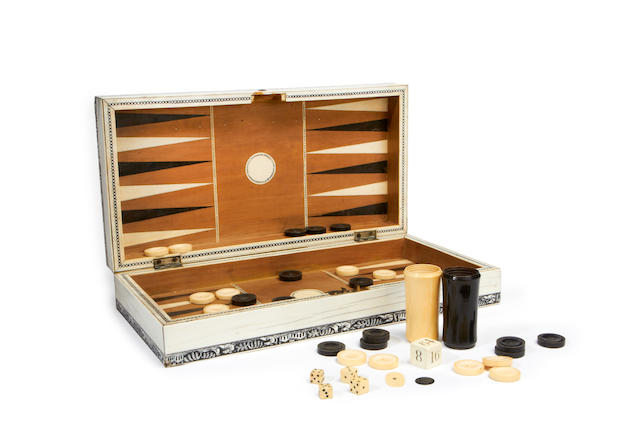 A 19th century Vizagapatam ivory and horn inlaid folding drafts and backgammon board