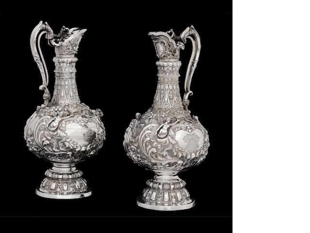 "A pair of Victorian Scottish silver ""Armada"" pattern wine ewers maker's mark JM in an oval punch, unrecorded, Glasgow 1857  (2)"